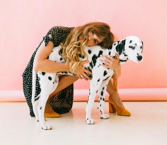 woman patting dalmatian