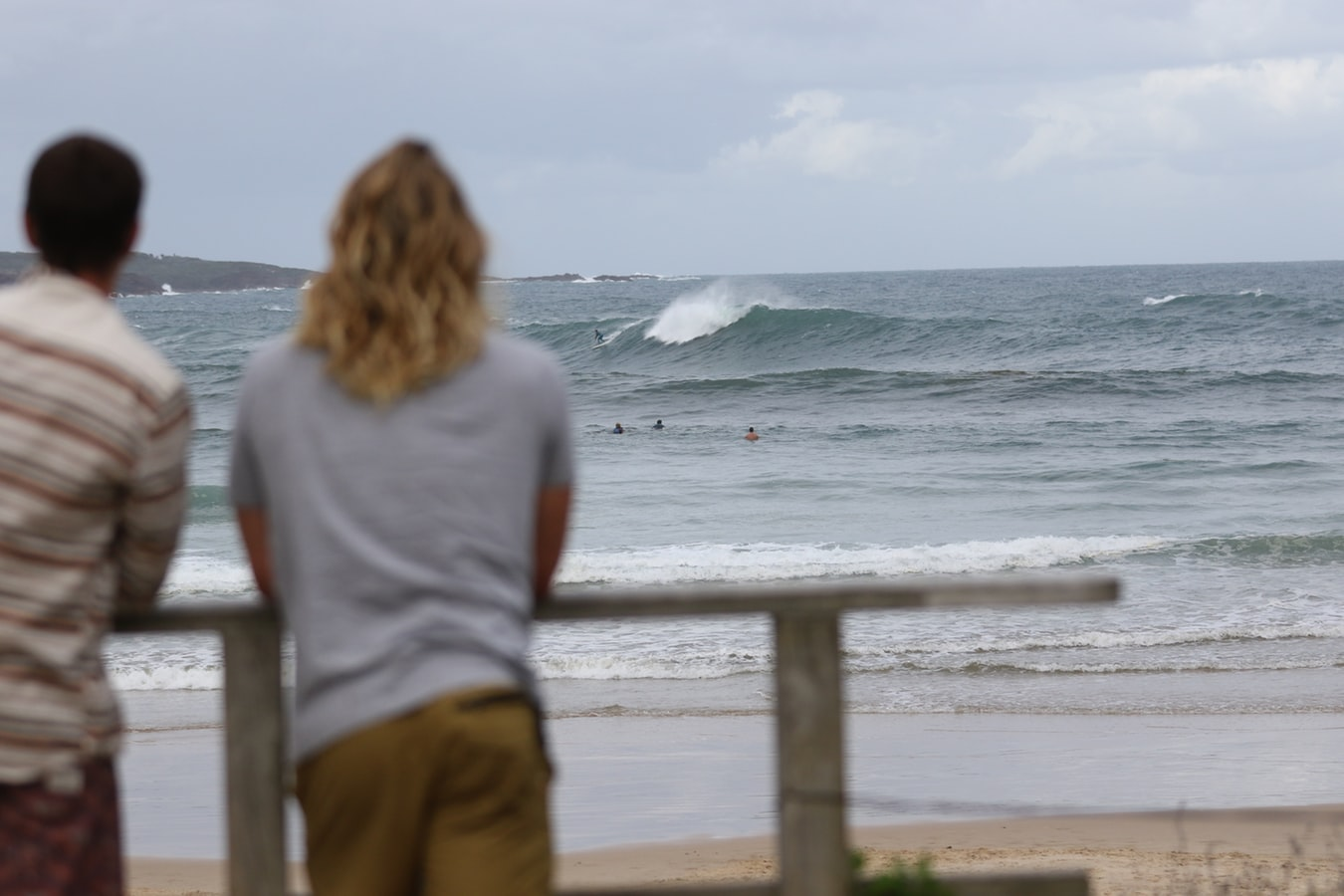 two friends looking out at the beach of Byron Bay