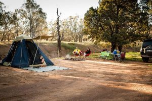 family camping, children in tent.