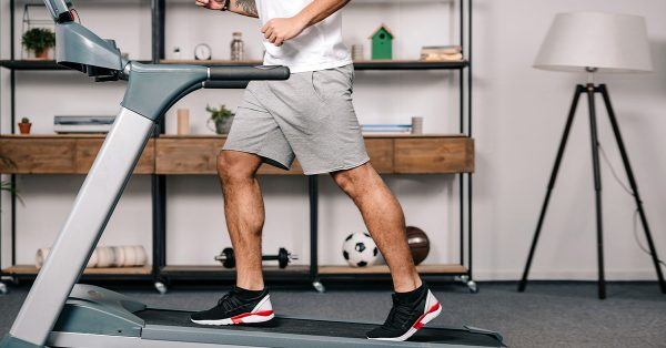 a man working out on a treadmill in his home