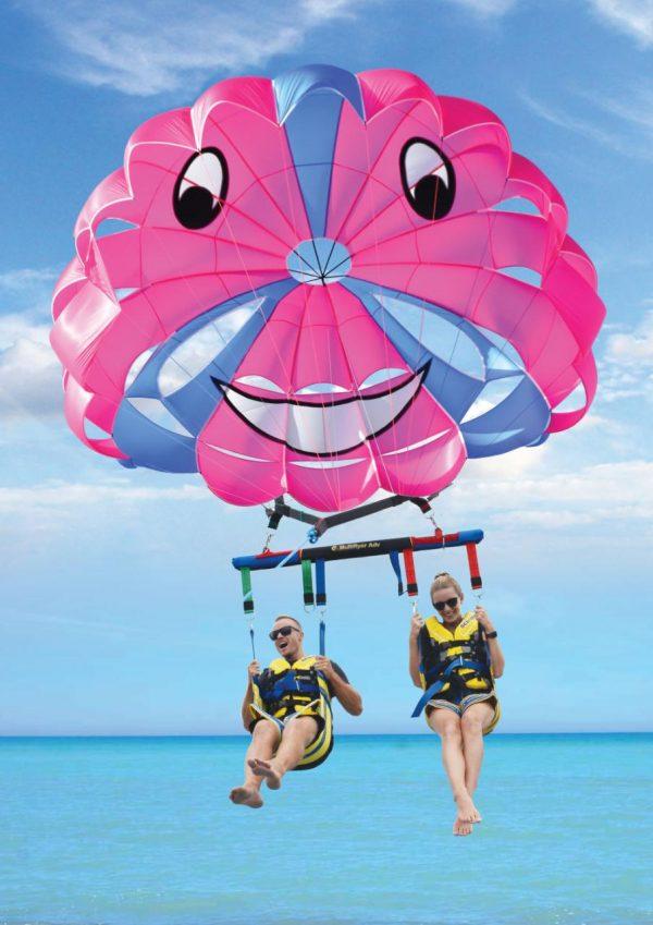 a couple parasailing on the beach