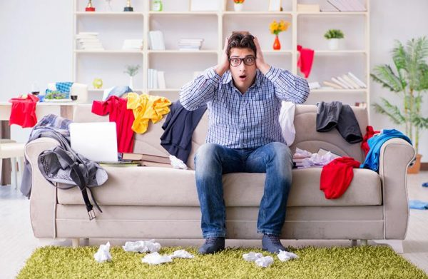 a man worried about his messy living room