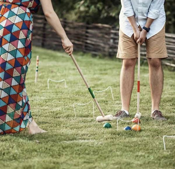 a couple player cricket at their backyard