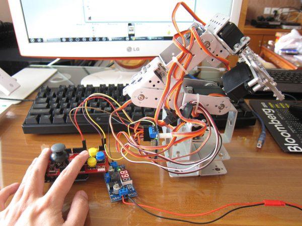a man building a mini robot