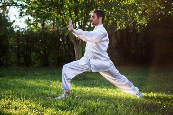 a man doing martial arts at his backyard