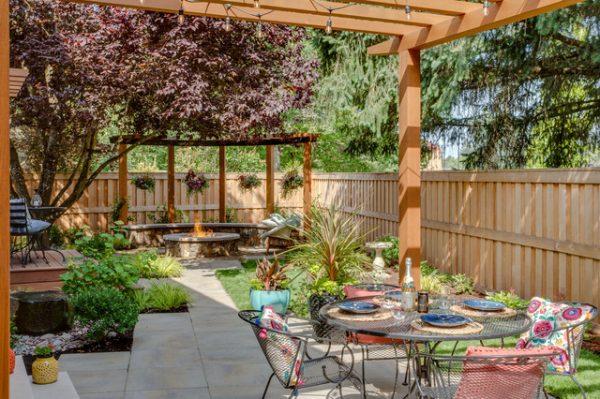 a simple backyard entertainment area near the garden