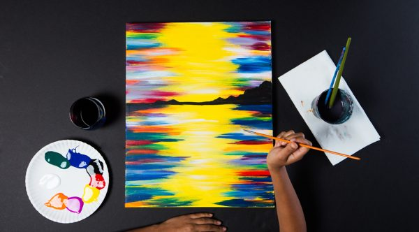 a person painting with different colors