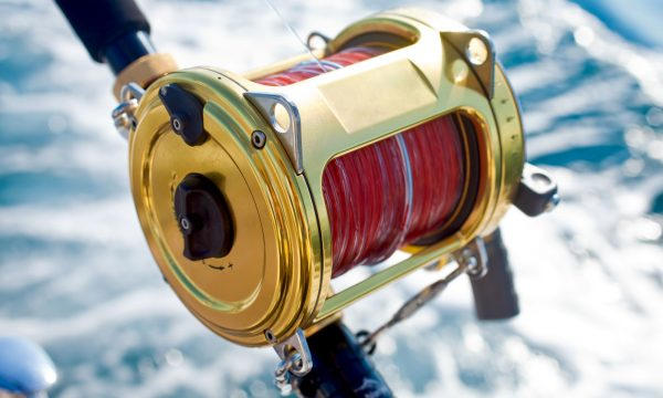 a gold plated fishing reel