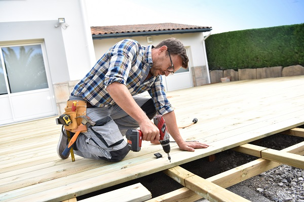 A handyman building a deck