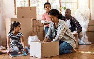 A family packing boxes