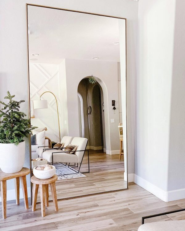 Huge mirror in a living room